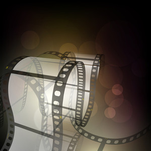 Film stripe or film reel on shiny movie background .