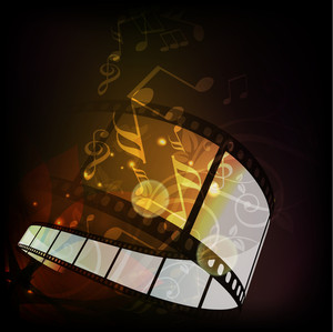 Film stripe or film reel on shiny music notes background.--