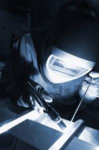 fine mechanic welder in action