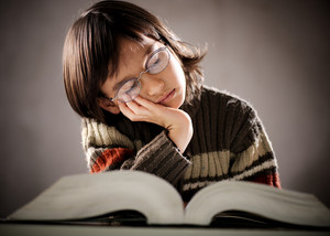 Fine portrait of cute little student kid falling asleep