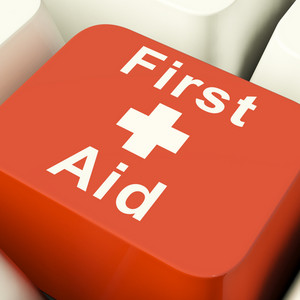 First Aid Computer Key Showing Emergency Medical Help