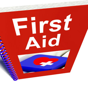 First Aid Manual Shows Emergency Medical Help