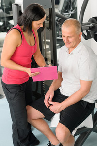 Fitness center personal plan happy active man with trainer