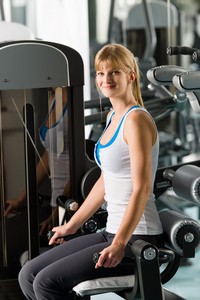 Fitness center young woman workout at gym