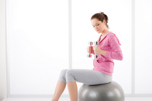 Fitness happy tired woman exercise dumbbell ball on white