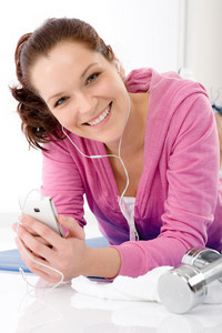 Fitness portrait of happy woman listen music mp3 gym