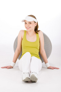 Fitness teenager woman in sportive outfit with exercise ball