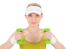 Fitness teenager woman with dumbbell in sportive outfit