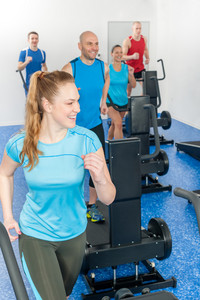 Fitness treadmill smiling woman enjoy group class at gym