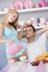 Flirtatious couple enjoying breakfast