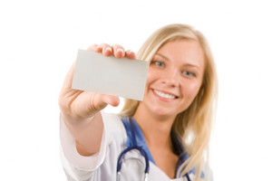 Focus on visiting card in happy female hand