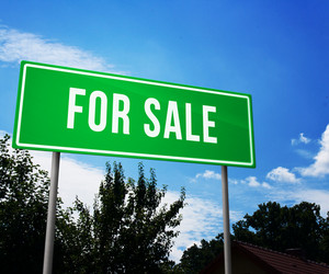 For Sale On Green Road Sign