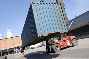 forklift hoisting containers for shipping