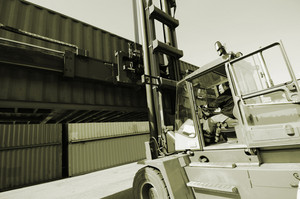 forklift in port stacking containers
