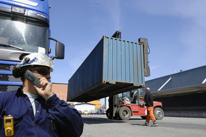 forklift loading truck in container port