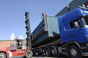 forklift loading truck in port