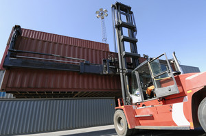 forklift stacking cargo containers