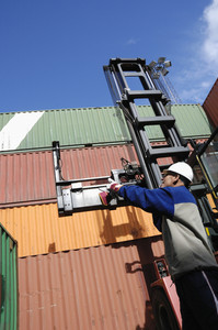forklift truck hoisting containers