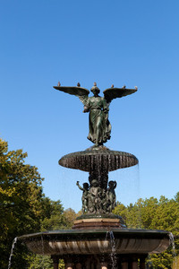 Fountain with an angel statue located in Central Park in New York City USA.