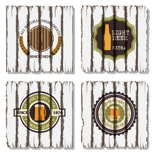 Four Beer Labels On Old Wood Background