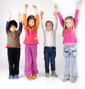 Four children group with arms up
