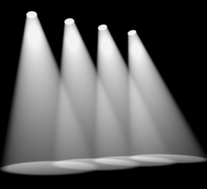 Four White Spotlights In A Row On Stage For Highlighting Products