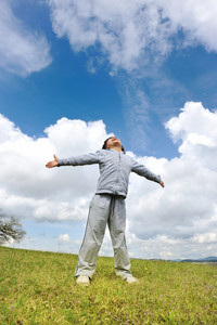 Freedom, kid on meadow, open arms