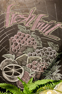 Fresh fruits and vegetables. Chalk drawing sign promoting healthy diet.