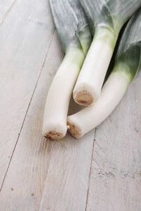 Fresh Leeks On Wooden Table