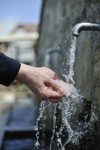 Fresh mountain water falling on hands