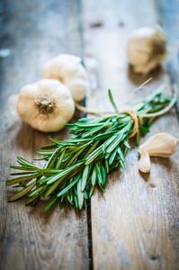 Fresh Rosemary With Fresh Garlic On Wooden Background