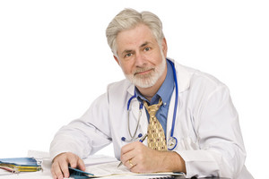 Friendly Doctor Doing Paperwork