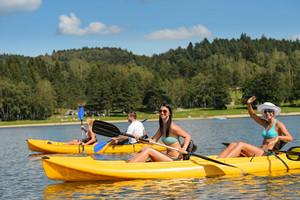 Friends enjoying summertime kayaking on river holiday freetime