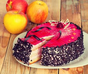 Fruit jelly sponge cake on wooden table