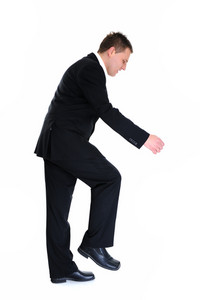 Full body portrait of walking businessman