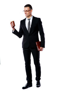 Full-length portrait of a businessman holding cup of coffee and tablet computer over white background