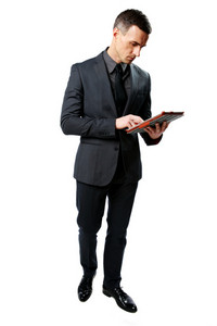 Full-length portrait of a businessman using tablet computer isolated on a white background