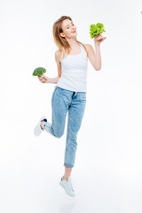 Full length portrait of a cheerful woman cauliflower and green salad isolated on a white backgorund