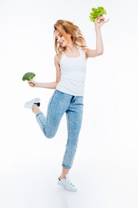 Full length portrait of a funny young woman cauliflower and green salad isolated on a white backgorund