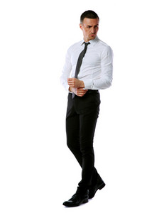 Full-length portrait of a handsome businessman isolated on a white background