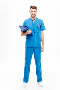Full length portrait of a happy male doctor standing with clipboard isolated on a white background
