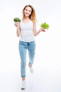 Full length portrait of a happy woman cauliflower and green salad isolated on a white backgorund