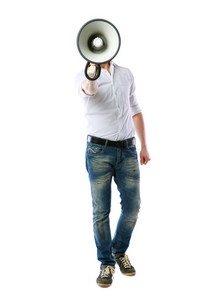 Full length portrait of a man with megaphone over white background