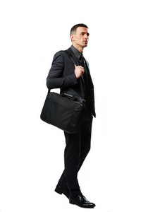 Full-length portrait of a pensive businessman with bag isolated on a white background