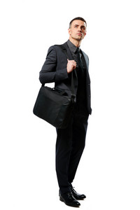 Full-length portrait of a thoughtful businessman with bag isolated on a white background