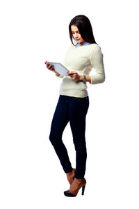 Full-length portrait of a young businesswoman holding tablet computer isolated on a white background