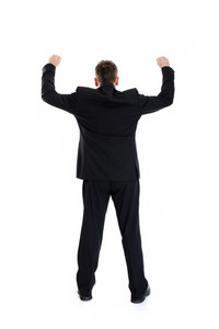 Full length portrait of businessman standing back with arms wide open, isolated