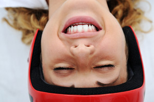 Funny girl with red helmet smiling