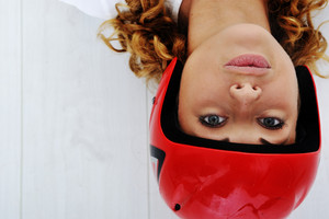 Funny girl with red helmet