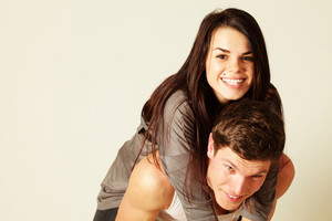 Funny young couple isolated